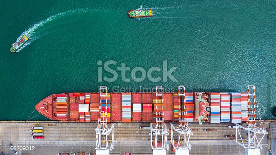 Container ship carrying container in import export business logistic and transportation of international by container ship in the open sea.