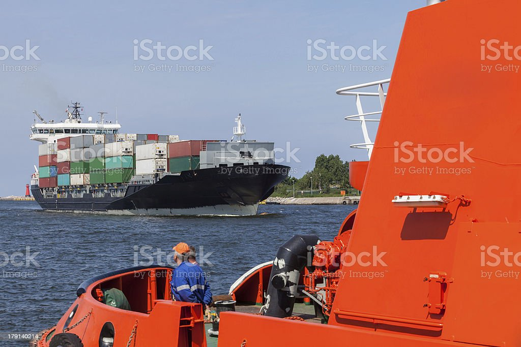 Container ship entering the port of Gdansk royalty-free stock photo