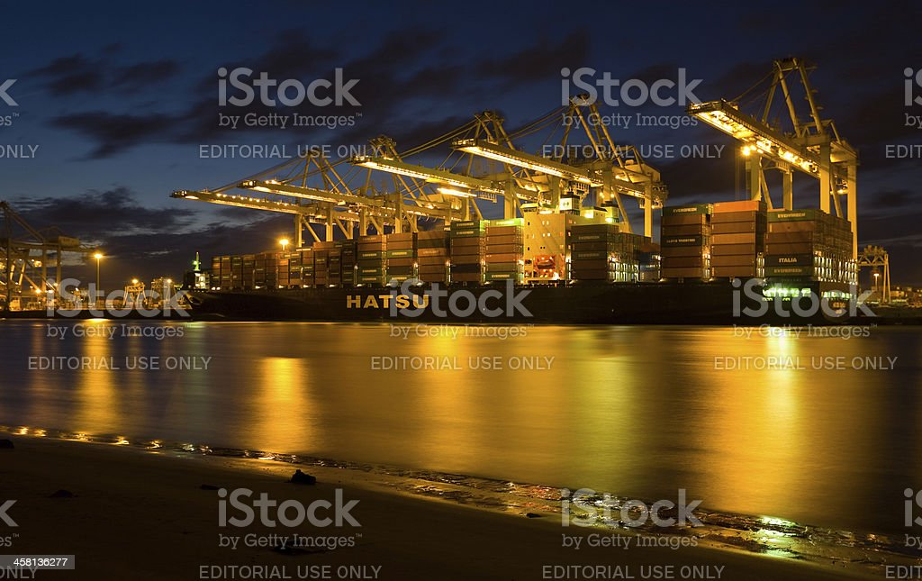 Container ship in a harbor royalty-free stock photo