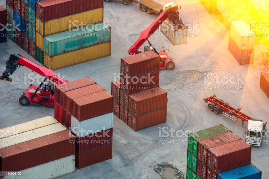Container ship in export and import business logistics and...