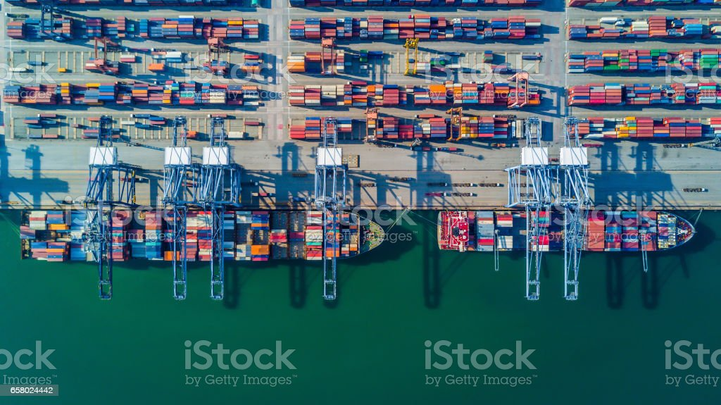 container ship in import export and business logistic by crane Aerial view from drone, container ship in import export and business logistic by craneAerial view from drone, container ship in import export and business logistic by crane Aerial View Stock Photo