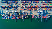 container ship in import export and business logistic by crane