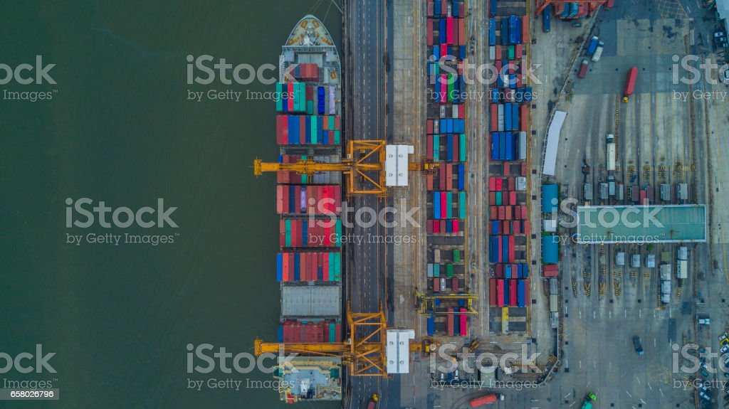 container ship in import export and business logistic by crane stock photo