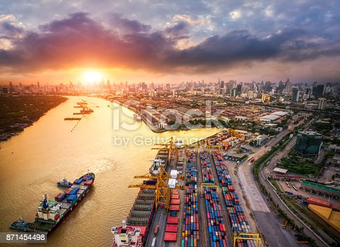 istock Container ship in import export and business logistic, By crane, Trade Port, Shipping cargo to harbor 871454498