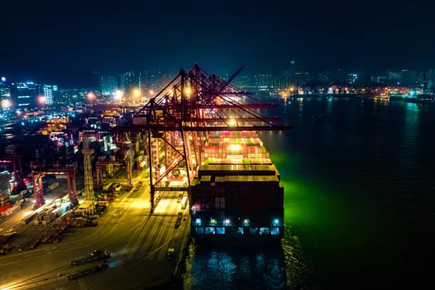container ship in import export and business logistic, international transportation, business logistics concept,night view, hong kong - drone shipyard night imagens e fotografias de stock