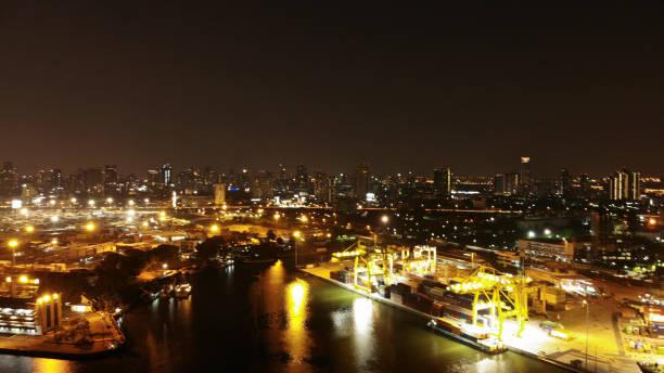 container ship in import export and business logistic, international transportation, business logistics concept,night view - drone shipyard night imagens e fotografias de stock