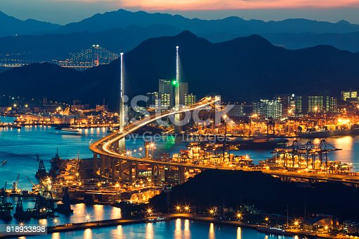 istock container ship in import export and business logistic with beautiful bridge over the sea 818933898