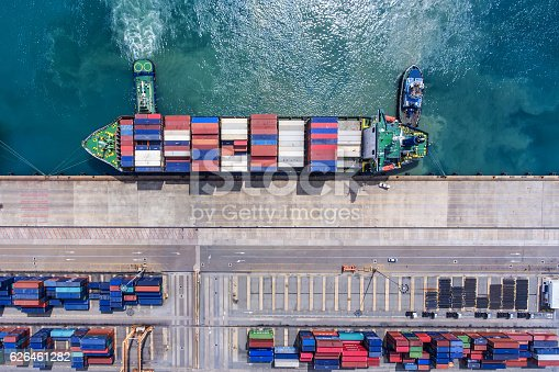 istock container ship in import export and business logistic.By crane , 626461282