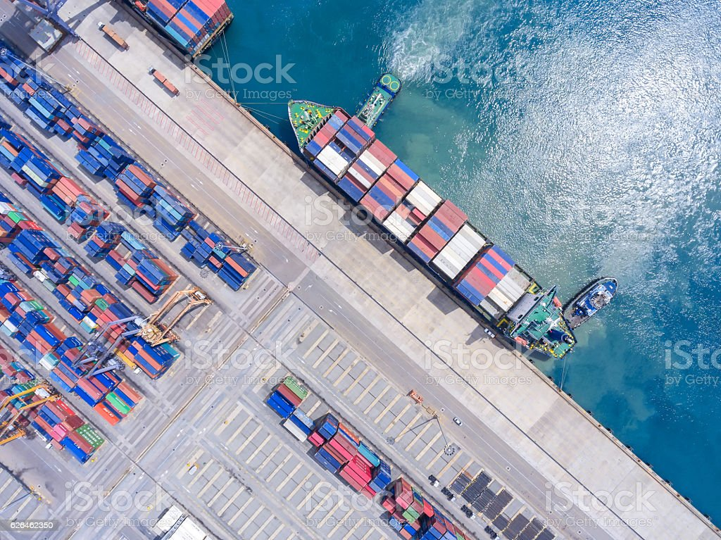container ship in import export and business logistic.By crane , stock photo