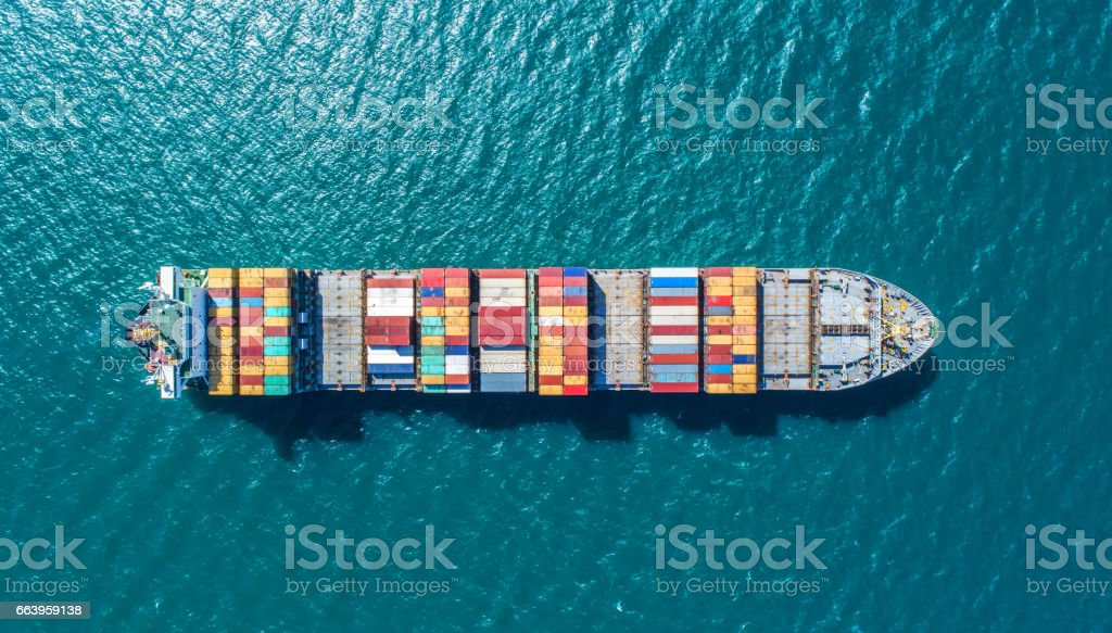 container ship in import export and business logistic.By crane ,Trade Port , Shipping.cargo to harbor.Aerial view.Water transport.International.Shell Marine.Top view. стоковое фото