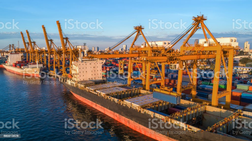 container ship in import export and business logistic.By crane ,Trade Port , Shipping.cargo to harbor.Aerial view.Top view. zbiór zdjęć royalty-free