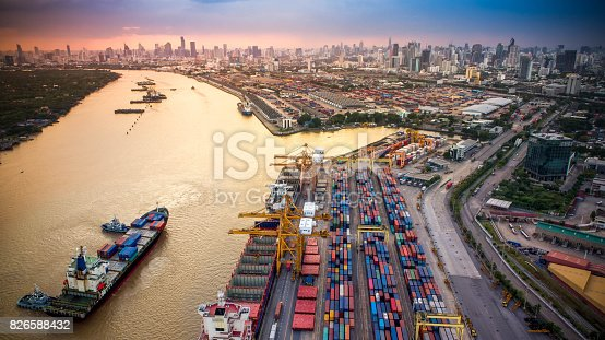istock Container ship in import export and business logistics, By crane, Trade Port, Shipping cargo to harbor 826588432