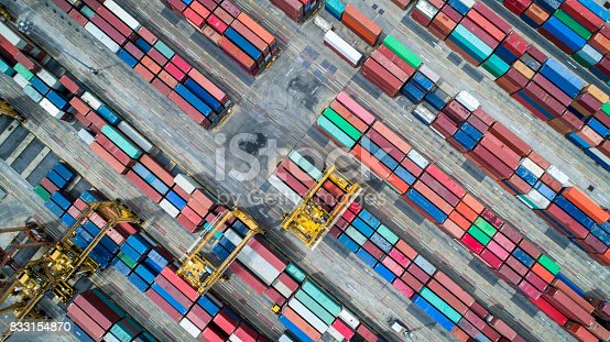istock Container ship in import export and business logistics, By crane, Trade Port, Shipping cargo to harbor, Aerial view from drone, International transportation, Business logistics concept 833154870