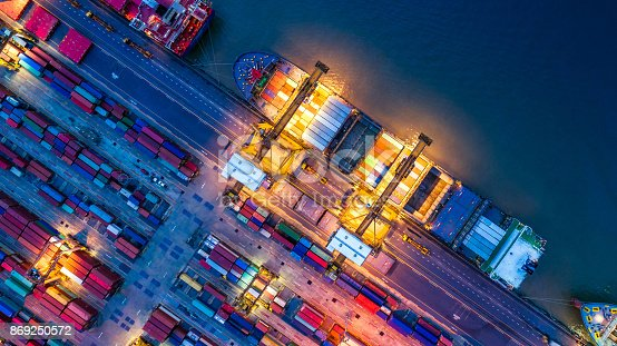 istock Container ship in import export and business logistics, By crane, Trade Port, Shipping cargo to harbor, Aerial view from drone, International transportation, Business logistics concept 869250572