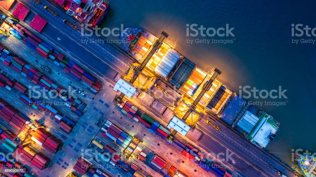 Container ship in import export and business logistics, By crane, Trade Port, Shipping cargo to harbor, Aerial view from drone, International transportation, Business logistics concept stock photo
