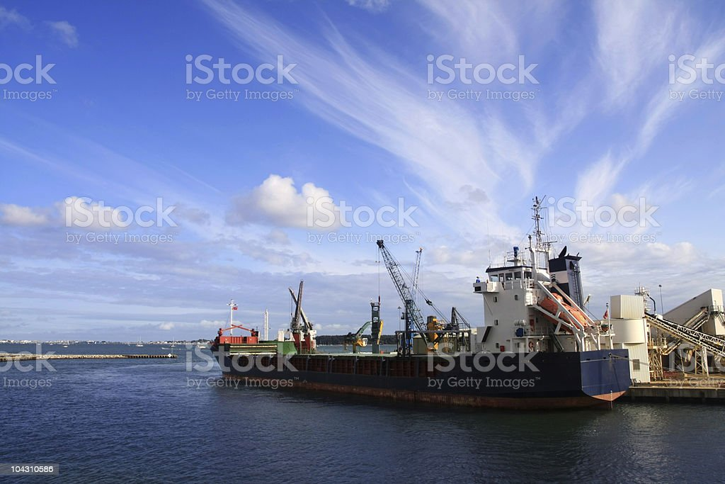 Container ship in Pool Harbour, UK stock photo