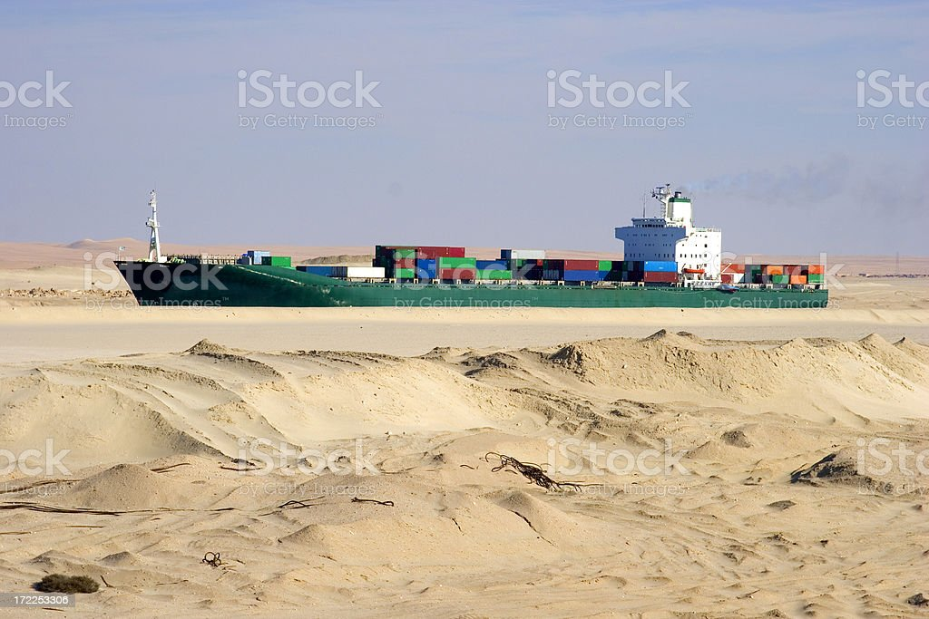 Container ship in the desert stock photo