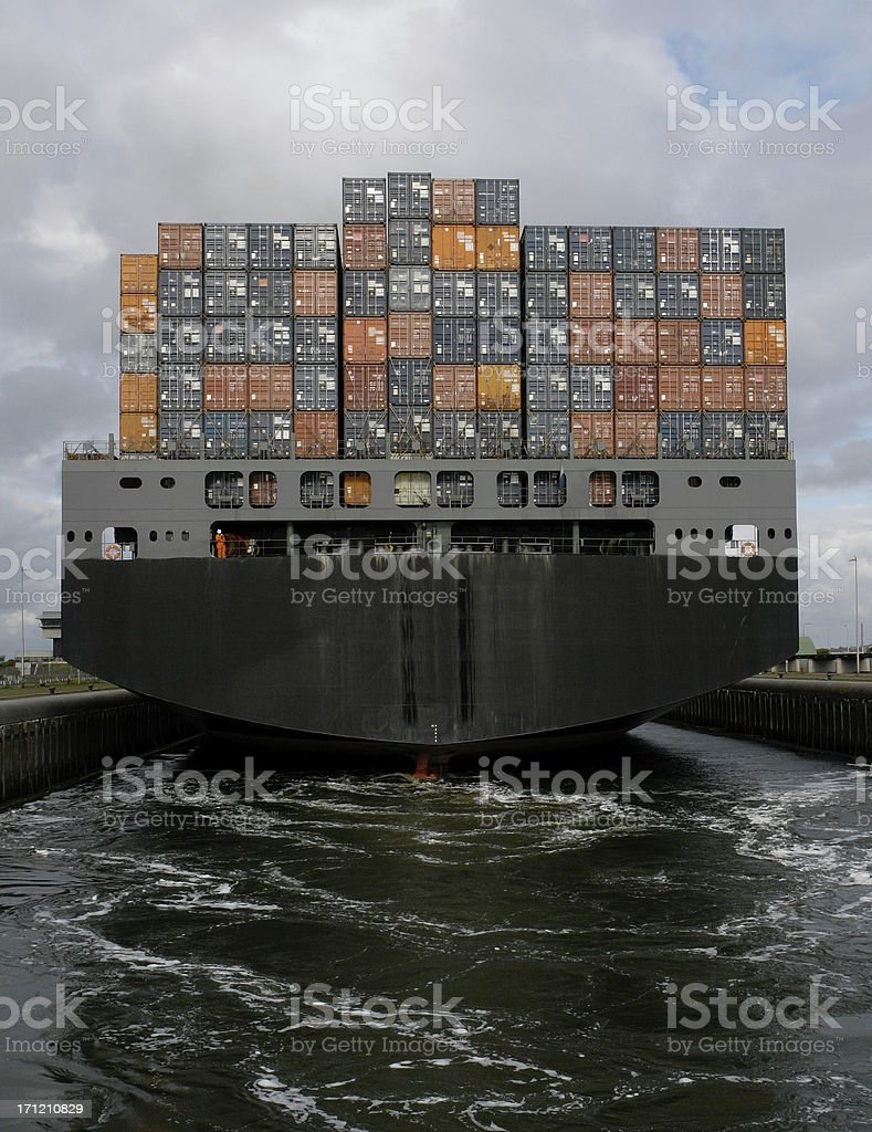 Container ship leaving stock photo
