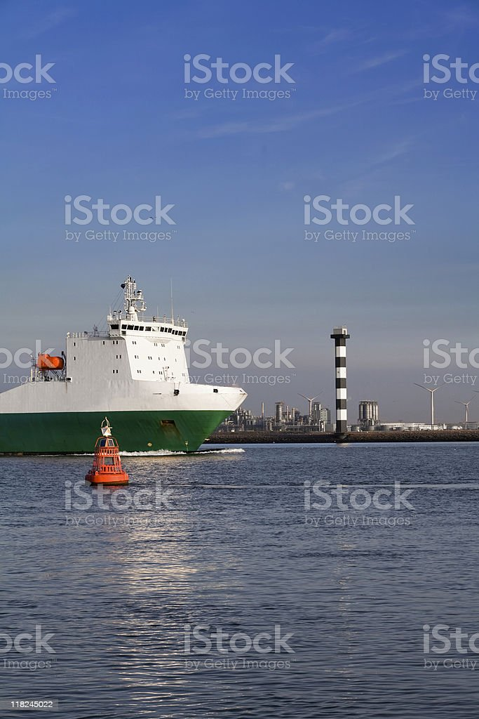 Container ship leaving Port of Rotterdam at dusk royalty-free stock photo