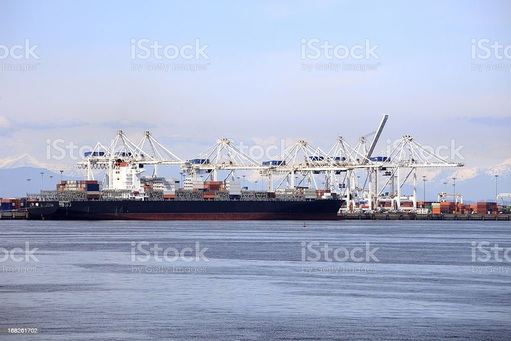 Container ship loading at busy port royalty-free stock photo