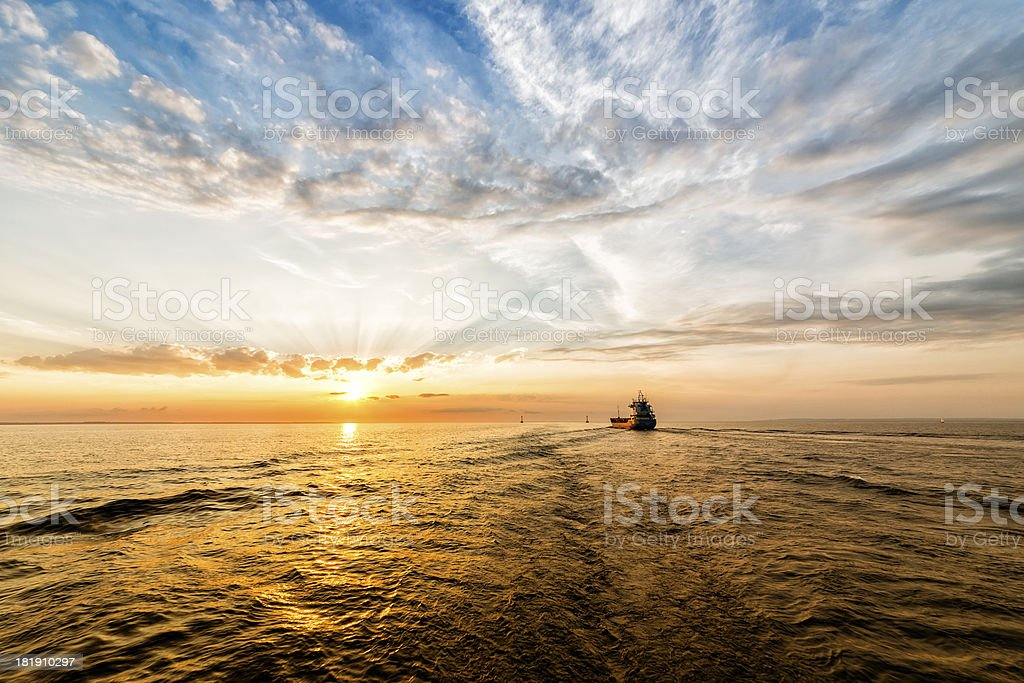 Container Ship on Sea Road during Sunset. royalty-free stock photo
