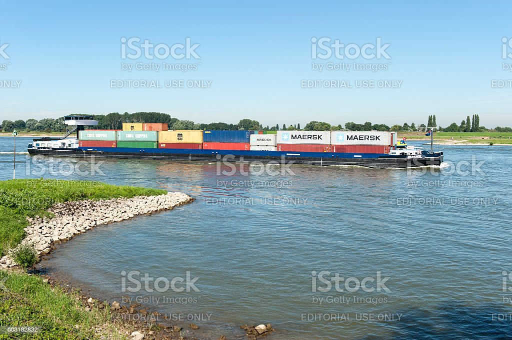 Container ship on the river Waal in The Netherlands stock photo