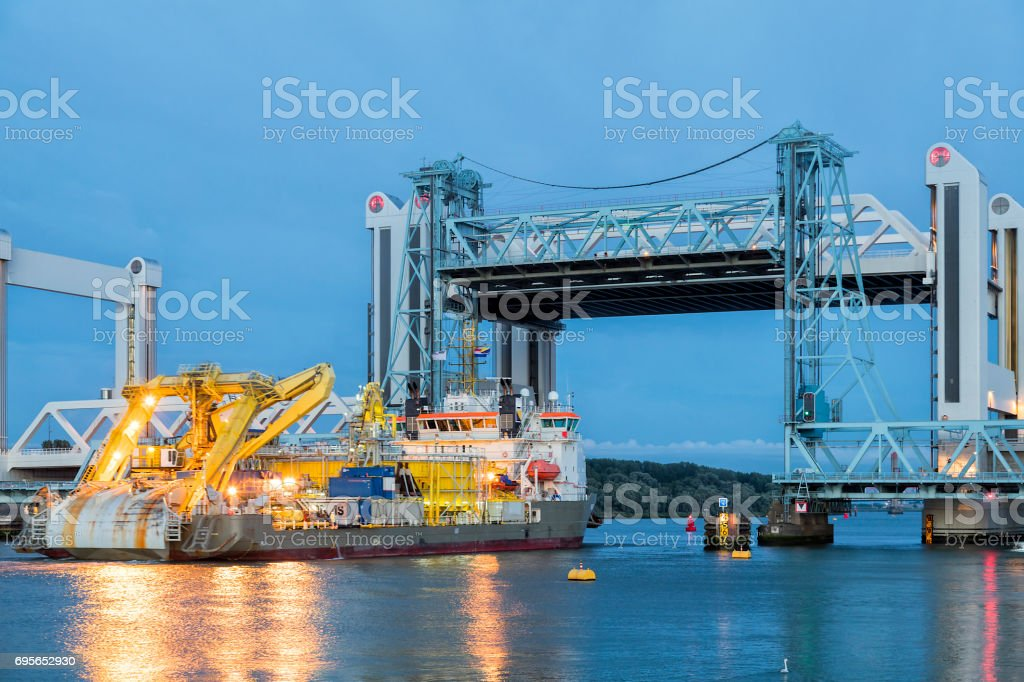 Container Ship Passing under Bascule Bridge in in Rotterdam, Netherlands stock photo