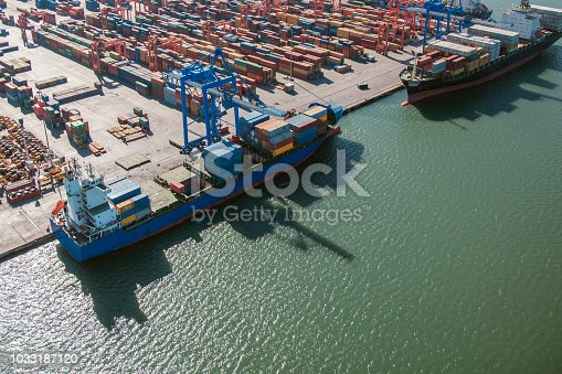 container ships waiting in port shot from above