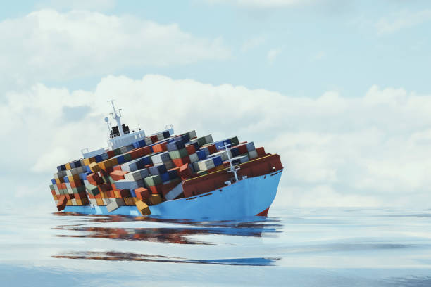 Container ship toppling over stock photo