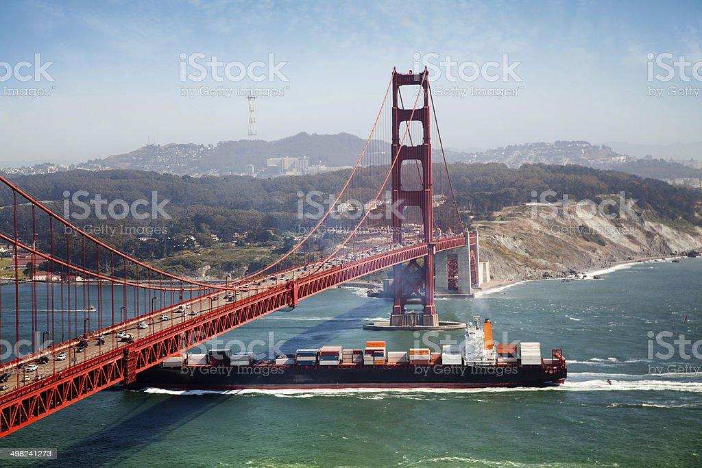 container ship under golden gate bridge in san francisco stock photo
