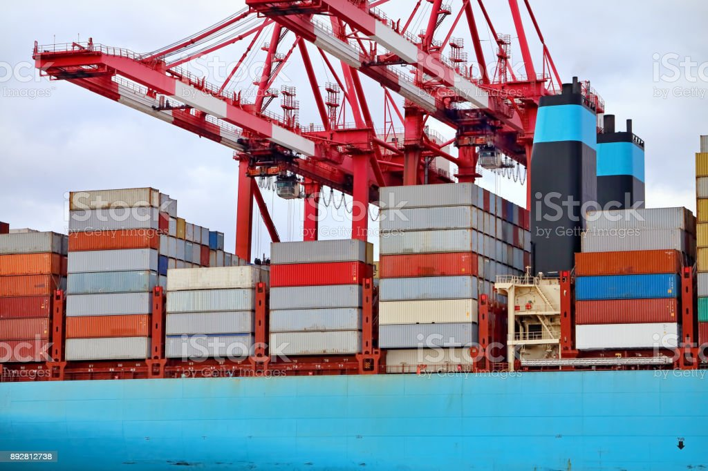 Container ship with cranes stock photo
