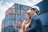 istock Container Shipping Logistics Engineering of Import/Export Transportation Industry, Transport Engineers Teamwork Controlling Management Containers Box on Laptop at Port Ship Loading Dock. Business Team 1264742102