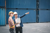 istock Container Shipping Logistics Engineering of Import/Export Transportation Industry, Transport Engineers Teamwork Controlling Management Containers Together at Port Ship Loading Dock. Business Team 1269640637