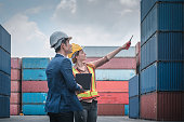 istock Container Shipping Logistics Engineering of Import/Export Transportation Industry, Transport Engineers Teamwork Controlling Management Containers Together at Port Ship Loading Dock. Business Team 1271339853