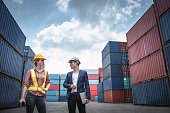 istock Container Shipping Logistics Engineering of Import/Export Transportation Industry, Transport Engineers Teamwork Controlling Management Containers Together at Port Ship Loading Dock. Business Team 1281274309