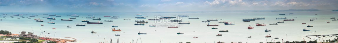 istock Container ships cargo freighter shipping moored in ocean harbour panorama 168856378