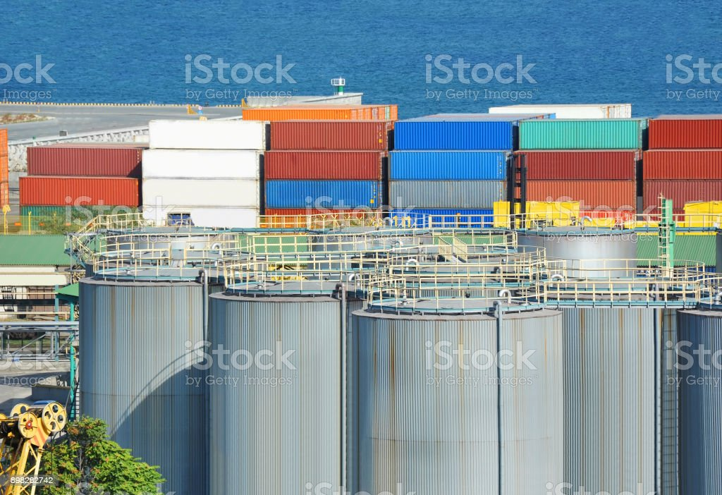 Container stack and cistern stock photo