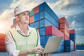 istock Container Supervisor Control Import/Export While Inspecting Containers Box in Warehouse Storage Distribution. Container Logistics Shipping Controlling of Transportation Industry, Cargo Ship Factory 1282427597