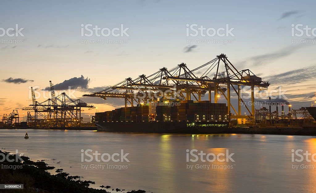 Container terminal at sunset - Royalty-free Blue Stock Photo
