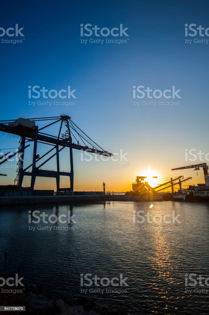 Container terminal in the evening stock photo