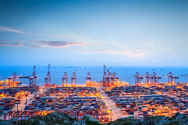 container terminal in twilight stock photo