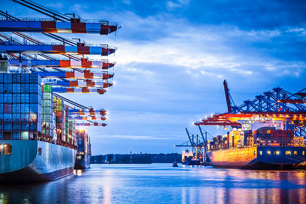 Container Terminal Container terminal with huge container cargo ship ready for unloading container ship stock pictures, royalty-free photos & images