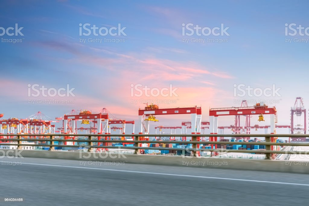 container terminal with highway in sunset - Royalty-free Asia Stock Photo