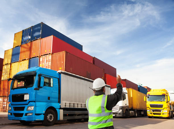container terminal with trucks  with freight forwarding manager,worker stock photo