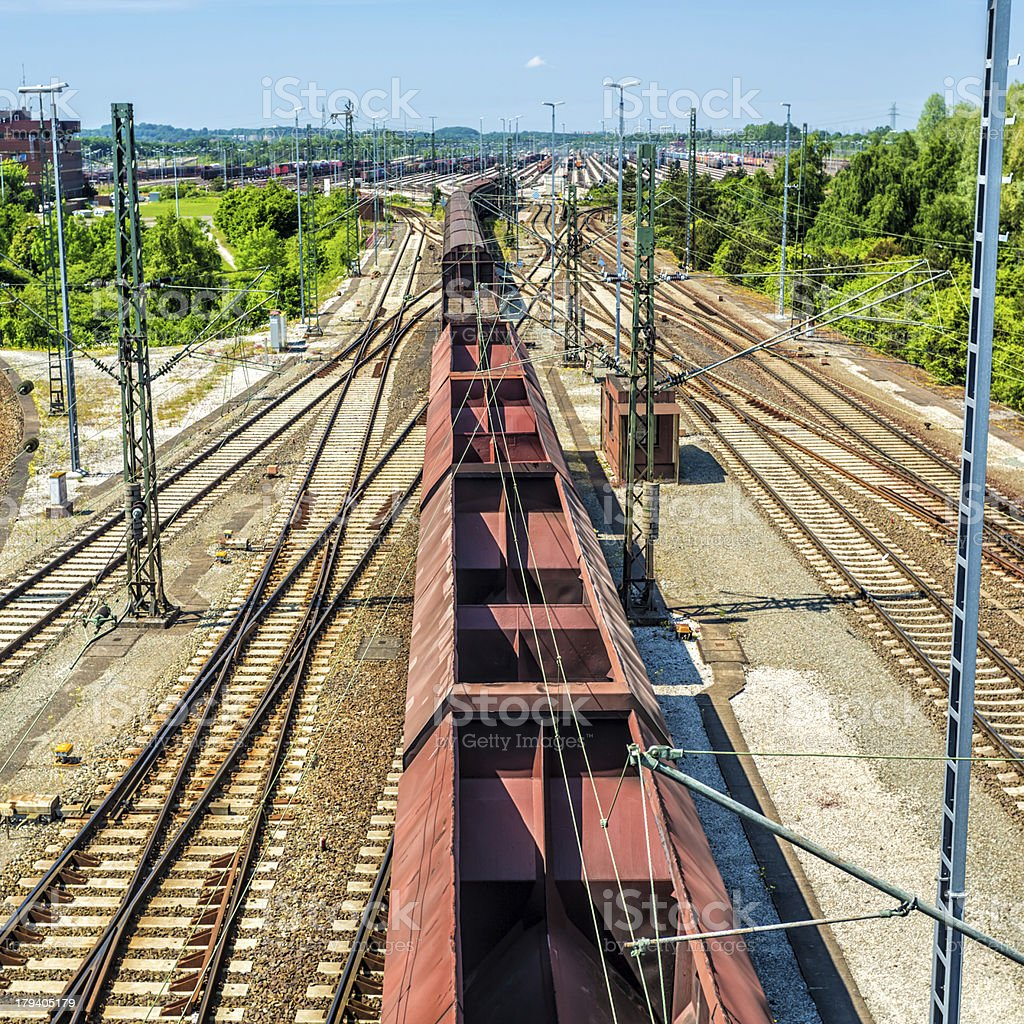 Container train snaking along tracks royalty-free stock photo