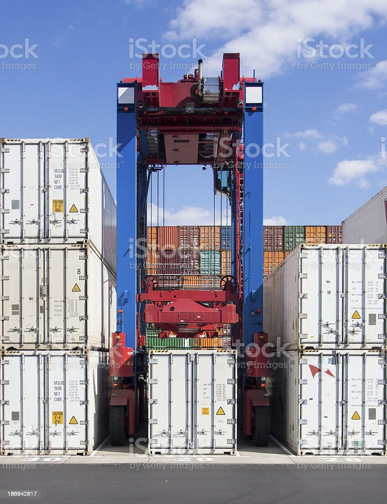 Container Transporter picking up cargo stock photo