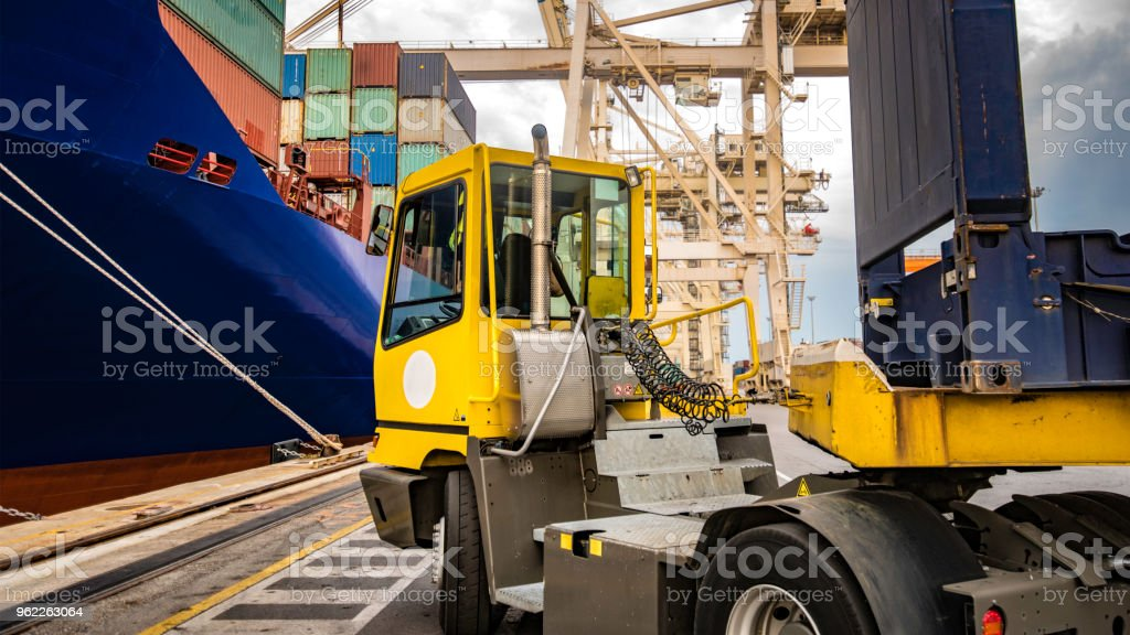 Container truck and cargo ship stock photo