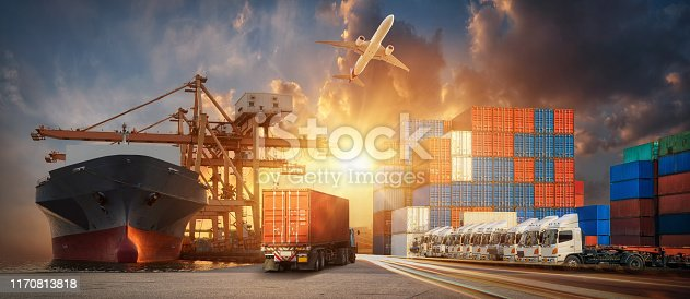 istock Container truck in ship port for business Logistics and transportation of Container Cargo ship and Cargo plane with working crane bridge in shipyard at sunrise, logistic import export and transport industry background 1170813818