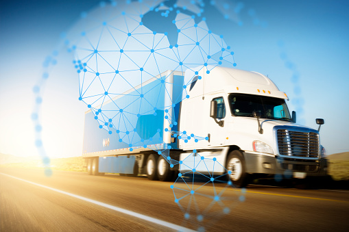 185274311 istock photo Container Truck on Highway with Polygon Network Pan Americas Globe Graphic 1263553178