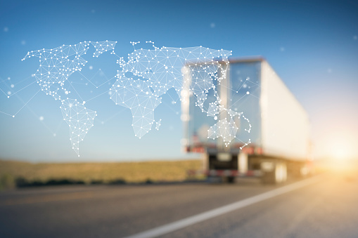 185274311 istock photo Container Truck on Highway with Polygon Network World Map Graphic 1190325597